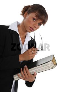 Woman holding folder full of paperwork