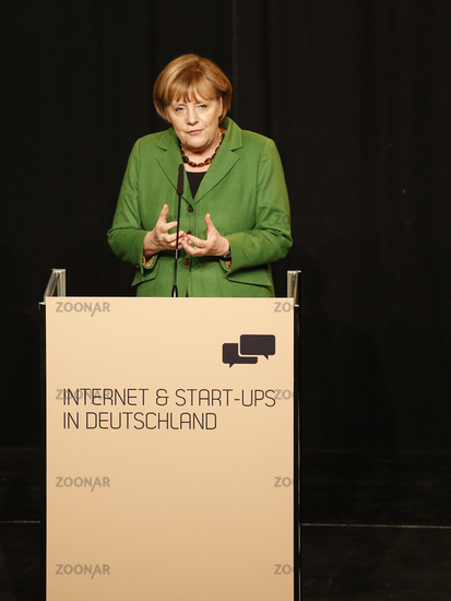 Chancellor Angela Merkel holds at the reception