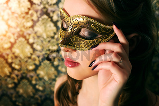 Beautiful girl in carnival mask