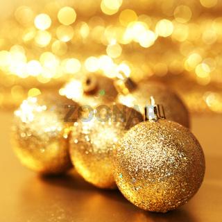 golden christmas ball on golden bokeh background