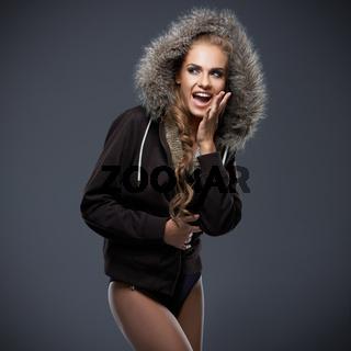 Beautiful woman in a fur trimmed hood