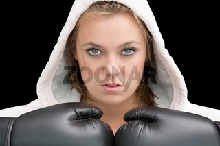 Woman wearing boxing gloves and robe