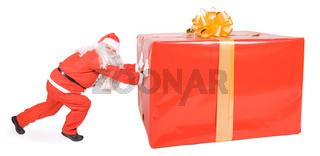 Santa Claus pushing at a big gift
