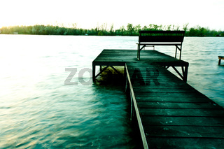 A pier on the shore in cold color