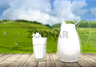 Pitcher and glass of milk on wooden table