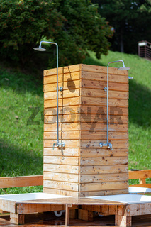 Outdoor Modern Shower Made From Brown Wooden Panels Near Swimming Pool