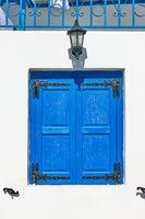 Trditional blue shutters in Mykonos