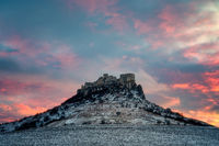 Old Spis Zipser Castle above valley at sunset