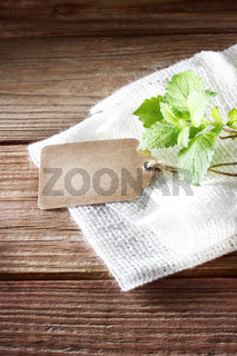 Tag on rustic wooden table with burlap
