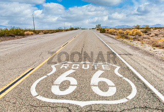 Route 66 road sign with blue sky background. Classic concept for travel and adventure in a vintage way.