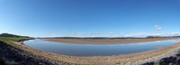 panoramic view of the river kent near arnside and sandside in cumbria with surrounding lakeland hills