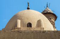 Dome at mosque of Sultan Al Nassir Qalawun revealing minaret of El Zaher Barquq Mosque, Cairo, Egypt
