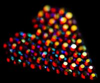 Colorful strass heart pattern on black background