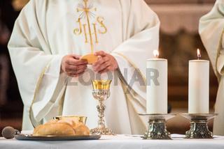 Priest giving Eucharist