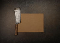 Vintage butcher meat cleaver and brown paper