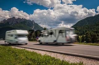 Family vacation travel, holiday trip in motorhome RV, caravan car motion blur