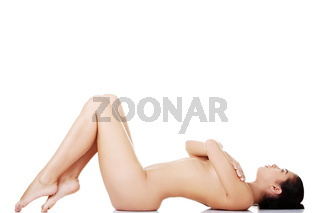 Sexy naked woman  lying down