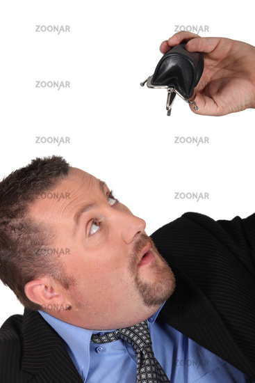 businessman looking at his  empty wallet