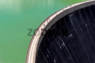 Visitors walk across the dam wall of Kaprun Alpine Reservoirs