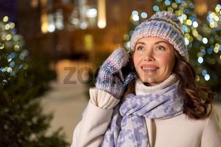 happy woman calling on smartphone on christmas