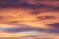 Sky full of clouds of different colors in a sunset