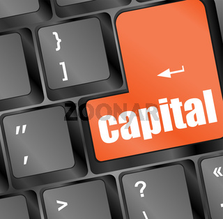 capital button on keyboard - business concept