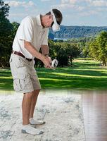 Senior adult man playing a golf game on a modern VR headset