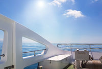 View of the calm sea from the deck of a luxury yacht, the concept of relaxing on the water and a romantic trip
