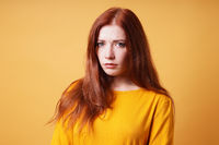 sad young woman looking worried and depressed
