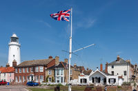 SOUTHWOLD, SUFFOLK, UK - JUNE 2 : Union jack flag flying near the lighthouse in Southwold Suffolk on June 2, 2010. Four unidentified people.