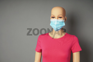 store window mannequin or display dummy wearing medical face mask