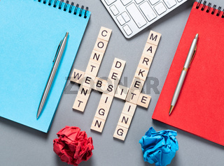 Web marketing concept with letters on cubes