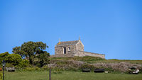 ST IVES, CORNWALL, UK - MAY 13 : View of the ancient Chapel of St Nicholas at St Ives, Cornwall on May 13, 2021. One unidentified person