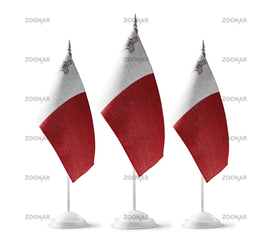 Small national flags of the Malta on a white background
