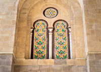 Two external adjacent perforated stucco arched windows with colorful stain glass patterns, at Qalawun complex, Cairo
