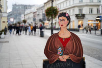 Warsaw, Poland, Nov 15, 2018: Painted plywood outdoor restaurant menu with a figure of Frida Kahlo, a famous Mexican painter, displayed on the street