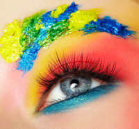 Close-up macro shot of teenager girl eye with unusual art make-up.