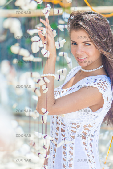 Woman in white dress on vacation