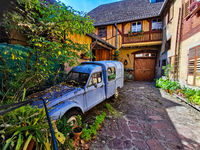Old car in old town in Elsass in France. Vibrant colors,