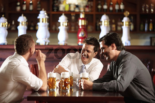 Three men in shirts in the bar