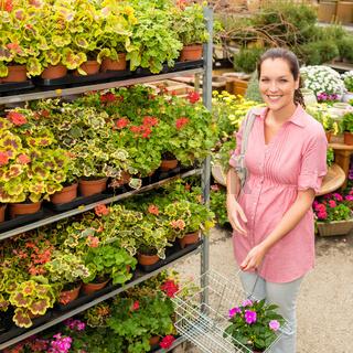 Garden centre woman shopping plants