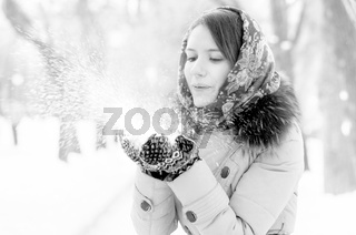 woman is blowing snow
