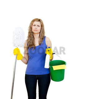 Angry woman against white background with cleaning utensils