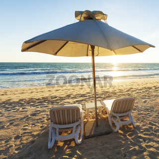Two beach chairs and parasol