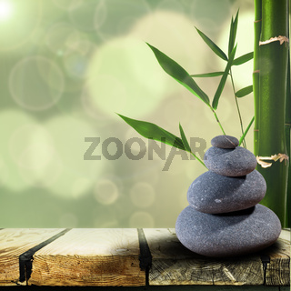 Abstract asian backgrounds with pebble over wooden desk
