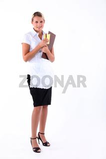 Full length studio shot of a waitress with menu and order pad