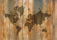 World map on old wooden wall background