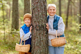 grandmother and grandson with mushrooms in forest