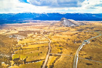 Lika region. Zir hill and Velebit mountain in Lika landscape aerial view. A1 highway.
