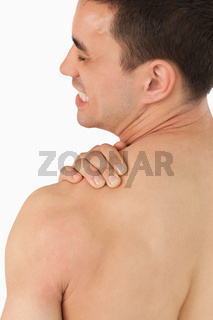 Young male experiencing neck pain
